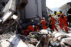 October 1, 2018 - Palu, Central Sulawesi, Indonesia - A search and rescue team searching for paragliding member team victims at the Roa-roa hotel collapsed after an earthquake hit in Palu, Central Sulawesi Province, Indonesia. (Credit Image: © Panoramic via ZUMA Press)