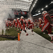 The University of Houston Cougars take the field prior to the game.<br /> <br /> Todd Spoth for The New York Times.