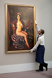© Licensed to London News Pictures. 16/11/2012. London, UK. A Sotheby's employee poses with 'La Oterito' (1936) (est. GB£500,000-700,000), a painting by Spanish artist Ignacio Zuloaga, at a press call taking place at the London based auction house's New Bond Street premises today (16/11/12).  The sale, featuring works by 19th century European painters, is set to take place on the 20th of November. Photo credit: Matt Cetti-Roberts/LNP