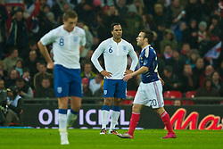 LONDON, ENGLAND - Wednesday, November 17, 2010: England's Joleon Lescott looks dejected as France score the opening goal against England during the International Friendly match at Wembley Stadium. (Pic by: David Rawcliffe/Propaganda)