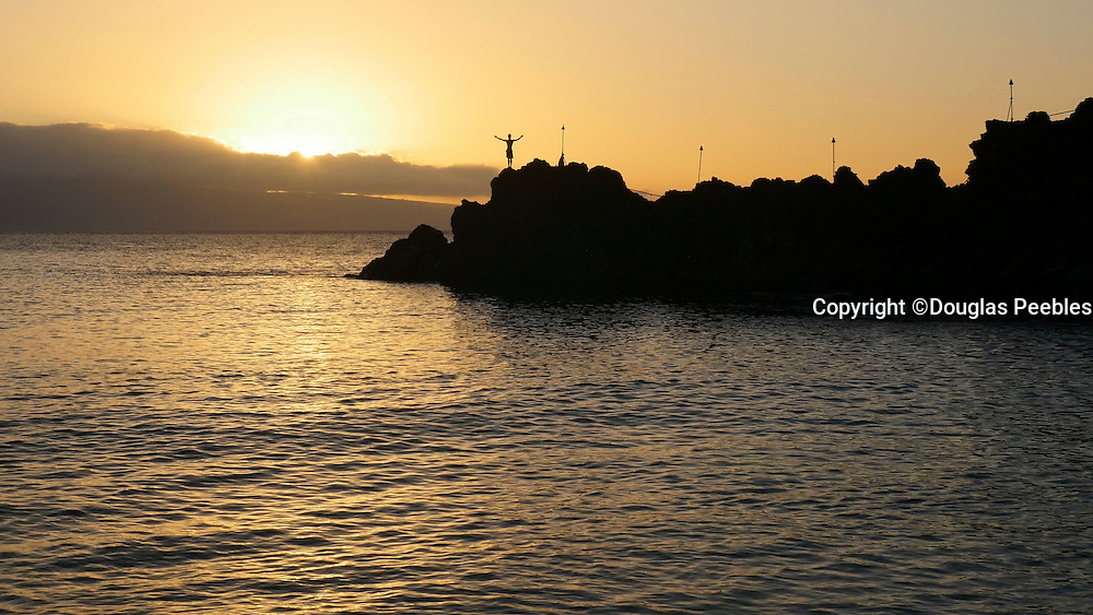 Cliff dive at sunset,Kaanapali Beach, Maui, Hawaii