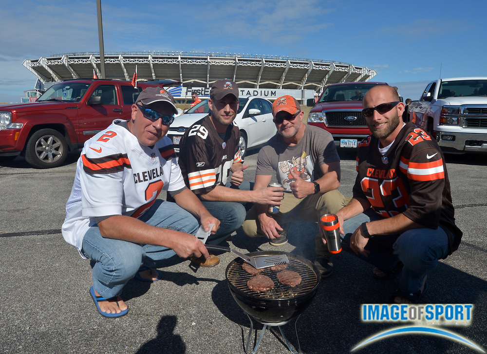 Sep 27, 2015; Cleveland, OH, USA; Cleveland Browns fans (from left) Curt Lautzenhiser, Derek Lautzenhiser, Dana Lautzenhiser and Drew Lautzenheiser tailgate before the NFL game against the Oakland Raiders at FirstEnergy Stadium. Mandatory Credit: Kirby Lee-USA TODAY Sports