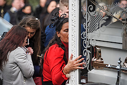 """© Licensed to London News Pictures. 13/02/2020. Sevenoaks, UK. A mourner kisses and touches a coffin outside St John the Baptist church in Sevenoaks, Kent ahead of he funeral of traveller brothers Billy and Joe Smith. The twin brothers, who were made famous by the television programme """"My Big Fat Gypsy Wedding"""", were found hanged in woodland three days after Christmas. Photo credit: Ben Cawthra/LNP"""
