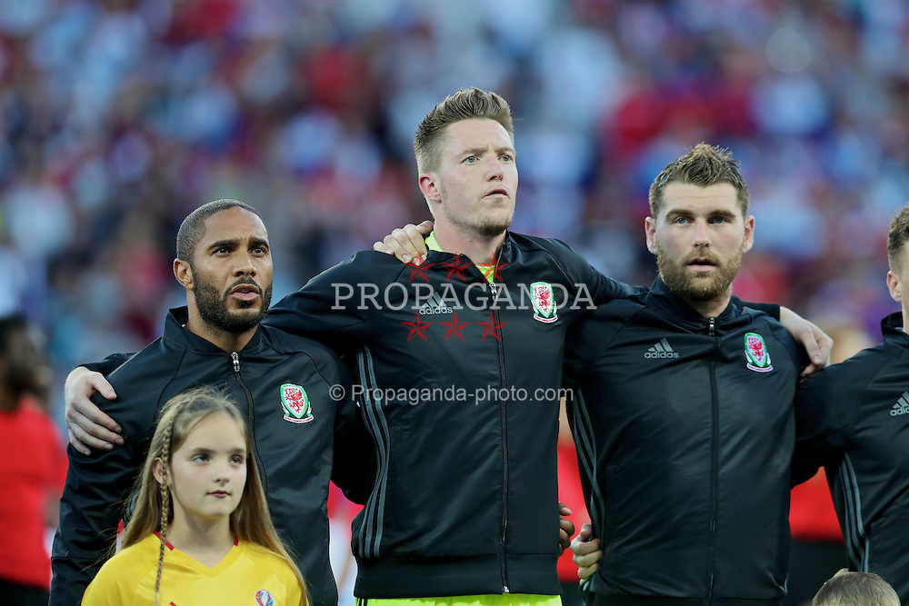 TOULOUSE, FRANCE - Monday, June 20, 2016: Wales' captain Ashley Williams, goalkeeper Wayne Hennessey and Sam Vokes sing the national anthem before the final Group B UEFA Euro 2016 Championship match against Russia at Stadium de Toulouse. (Pic by David Rawcliffe/Propaganda)