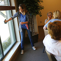 Lauren Wood | Buy at photos.djournal.com<br /> Elizabeth Stevens demonstrates window cleaning products during the Natural Cleaning Supplies class of the Mud and Magnolias Home and Garden Expo Saturday morning at the ICC Belden campus.