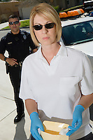 Police Officer with Evidence Envelope