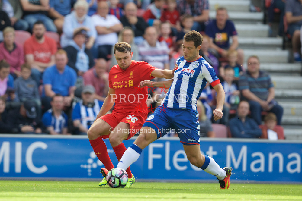 WIGAN, ENGLAND - Sunday, July 17, 2016: Liverpool's Connor Randall in action against Wigan Athletic's Yanic Wildschut during a pre-season friendly match at the DW Stadium. (Pic by David Rawcliffe/Propaganda)