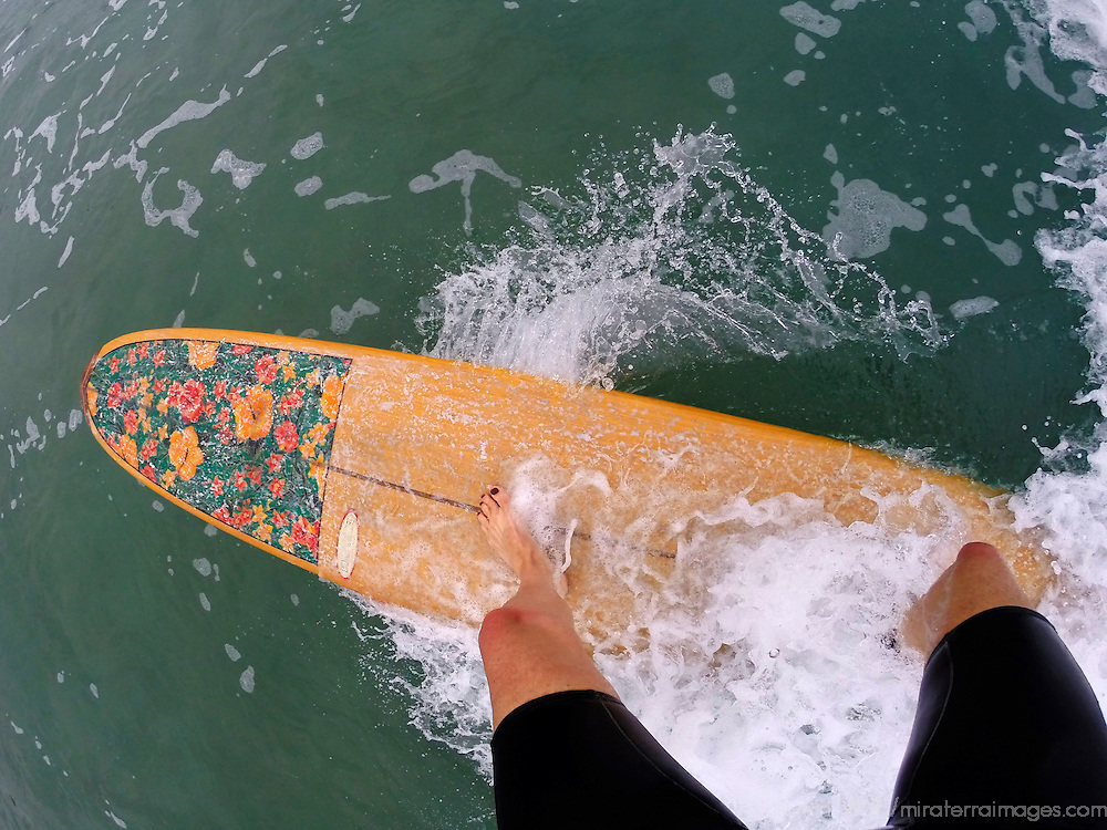 USA, California, San Diego. Longboard Surfing Female POV