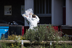© Licensed to London News Pictures . 25/05/2017 . Manchester , UK . Forensic examiners at Somerton Court on Broadmoss Drive . A police cordon around the tower block in Blackley , North Manchester , in which a 12th floor flat was rented by Manchester Arena bomber Salman Abedi , ahead of his murderous attack at an Ariana Grande concert on Monday 22nd May 2017 . Photo credit : Joel Goodman/LNP