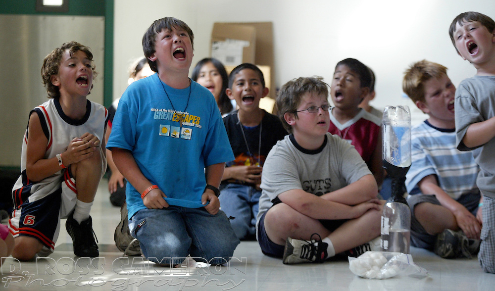 Campers sing a song at YMCA day camp, Redwood City, Calif., Friday, July 1, 2005. (Photo by D. Ross Cameron)