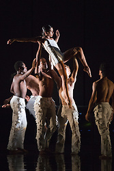 """© Licensed to London News Pictures. 16/10/2012. London, England. Estela Merlos at top. Rambert Dance Company perform the new pice """"Labyrinth of Love"""" by choreographer Marguerite Donlon at Sadler's Wells Theatre, London. Music by Michael Daugherty, visual imagery by Mat Collishaw. With the soprano Kirsty Hopkins. Photo credit: Bettina Strenske/LNP"""