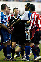 Photo: Gareth Davies.<br />Reading v Sheffield United. The Barclays Premiership. 20/01/2007.<br />Both set of players are broken up by Referee Mark Halsey (C) after Reading's Steven Hunt (out of pic) is elbowed by Sheffield United's Keith Gillespie (R 19)