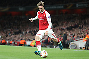 Arsenal defender Nacho Monreal (18) crossing the ball during the Europa League semi final first leg match between Arsenal and Atletico Madrid at the Emirates Stadium, London, England on 26 April 2018. Picture by Matthew Redman.