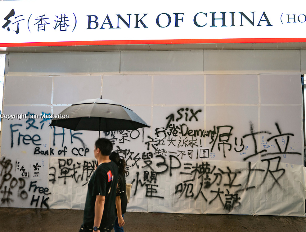 Hong Kong. 6 October 2019. Tens of thousands of pro-democracy protestors march in pouring rain through centre of Hong Kong today from Causeway Bay to Central. Peaceful march later turned violent as a hard-core of protestors confronted police. Pic; Vandalised Bank of China Branch.  Iain Masterton/Alamy Live News.