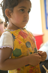 Nursery School girl playing,