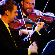 """January 8, 2012 - Manhattan, NY : The Calder Quartet's  Jacobson (violin), left, and Andrew Bulbrook (violin), perform Terry Riley's """"Cadenza On The Night Plain"""" at Le Poisson Rouge in Manhattan on Sunday evening.  CREDIT: Karsten Moran for The New York Times"""