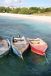 Fishing boats docked along the beach at Anguilla, Caribbean.<br />