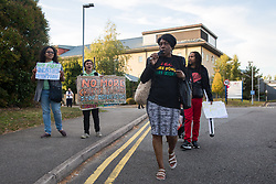 London, UK. 14 September, 2019. Activists from Movement for Justice, which campaigns against immigration detention and deportations, protest outside Harmondsworth detention centre following the death on 12th September of Oscar Okwurime, a detainee from Nigeria. According to the Home Office, the police, coroner and prisons and probation ombudsman are currently investigating his death in detention. Harmondsworth detention centre and its neighbour Colnbrook form Heathrow Immigration Removal Centre, the largest detention centre in Europe, which is run by the Care and Custody division of outsourcing giant Mitie.