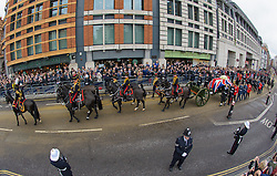 Former British Prime Minister Margaret Thatcher's cortege passes along Fleet Street watched by members of the public on it's way to the funeral at St. Paul's Cathedral in the City of London, London, UK, Wednesday 17 April, 2013, Photo by: Anthony Upton / i-Images