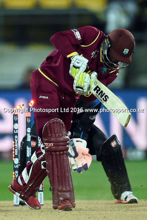 West Indies batsman Jonathan Carter bowled by Daniel Vettori during the ICC Cricket World Cup Quaterfinal match between New Zealand and West Indies at Westpac Stadium in Wellington, New Zealand. Saturday 21  March 2015. Copyright Photo: Raghavan Venugopal / www.photosport.co.nz
