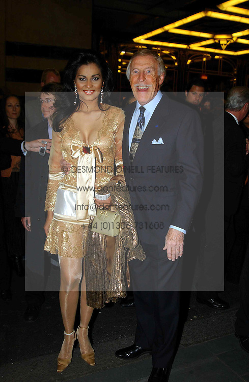 BRUCE FORSYTH and his wife WILNELIA at the opening night of the musical Murderous Instincts at The Savoy Theatre, London on 7th October 2004.<br /><br />NON EXCLUSIVE - WORLD RIGHTS