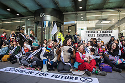London, UK. 2 December, 2019. Climate activist mothers from Extinction Rebellion Families nurse their babies outside the headquarters of the Labour Party as part of a roving nurse-in outside the premises of the various political parties to demand that they put the climate and ecological emergency at the heart of their general election campaigns.