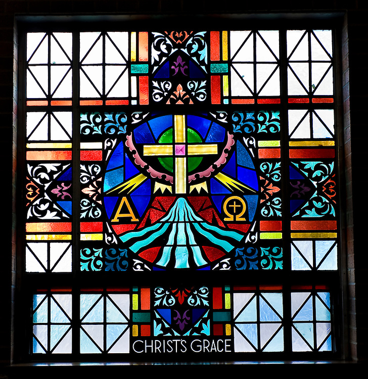 Stained glass image illustrating Sacrament of Anointing at St. Mary Church in Peshtigo, Wis. (Sam Lucero photo)