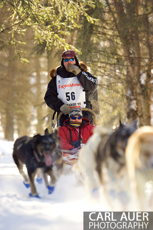March 7th, 2009:  Anchorage, Alaska: Aaron Burmeister of Nome, Alaska moves quickly through the woods near Behm Lake during the 2009 Ceremonial Start of the Iditarod.