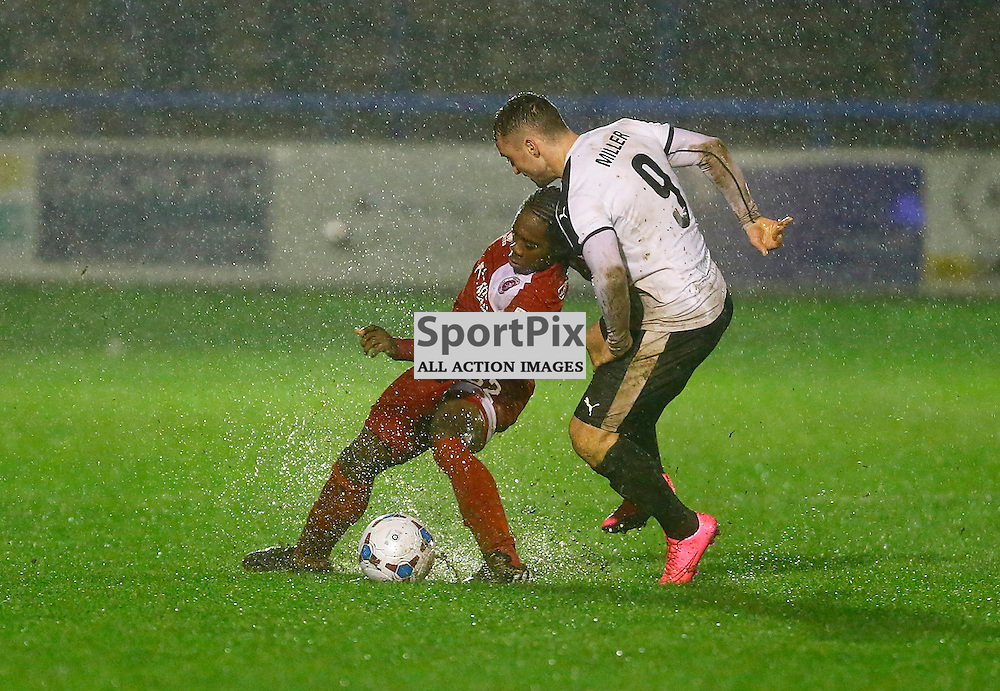 Dover's striker Ricky Miller (9)  and Welling's Reece Harris (22) The weather forced the game between Dover Athletic v Welling United to be abandoned shortly into the second half. Vanarama National League. 02  January 2016. (c) Matt Bristow | SportPix.org.uk