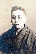 eroding identity portrait of adult man Japan ca 1930s