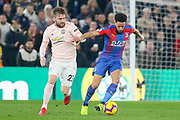 Crystal Palace #10 Andros Townsend battles with Manchester United Defender Luke Shaw during the Premier League match between Crystal Palace and Manchester United at Selhurst Park, London, England on 27 February 2019.