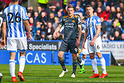 Jamie Vardy of Leicester City (9) and Jonathan Hogg of Huddersfield Town (6) in action during the Premier League match between Huddersfield Town and Leicester City at the John Smiths Stadium, Huddersfield, England on 6 April 2019.