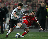 Photo: Lee Earle.<br /> Benfica v Liverpool. UEFA Champions League. 2nd Round, 1st Leg. 21/02/2006. Liverpool's Xabi Alonso (L) battles with Simao.