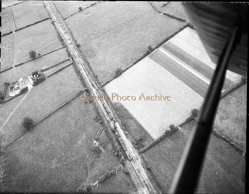 01/07/1960<br /> 07/01/1960<br /> 01 July 1960<br /> Aerial pictures of Westport - Dublin train derailed at Killucan, Co. Westmeath. Pictures taken from plane hired from Skycraft at Dublin Airport.