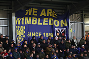 AFC Wimbledon fans in front of a We Are Wimbledon sign during the EFL Sky Bet League 1 match between AFC Wimbledon and Peterborough United at the Cherry Red Records Stadium, Kingston, England on 12 March 2019.