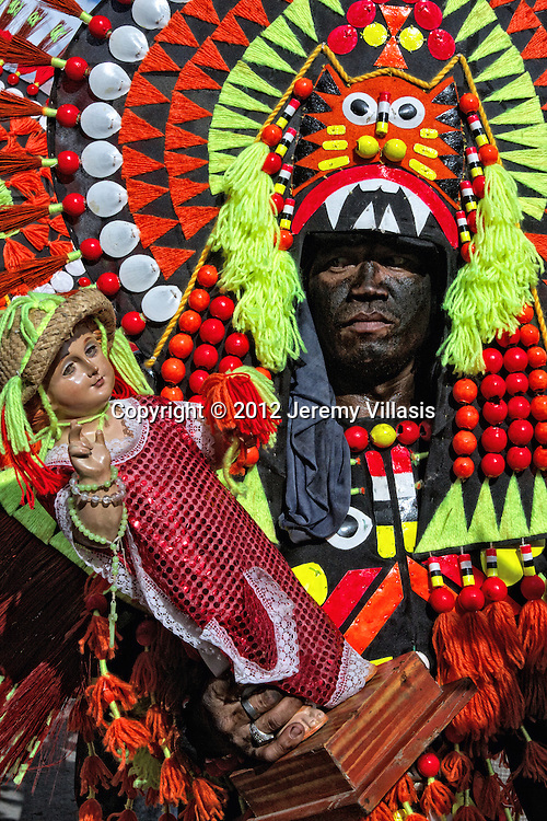 Ati-Atihan festival in Kalibo, Aklan. Considered as the mother of all Philippine festivals, the Ati-Atihan is celebrated in honor of the Christ child (Santo Niño) and the Aetas, the first settlers of the island of Panay. Kalibo, the Philippines.