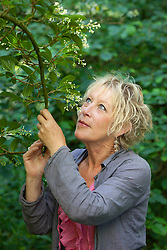 Carol Klein enjoying the scent of viburnum