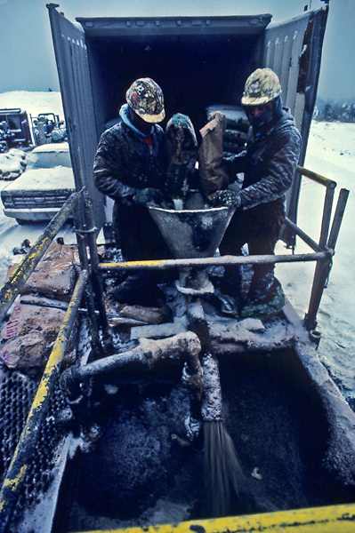 Stock photo of roughnecks in the winter at a job site in Colorado at an oil rig in the Eagle Ford Shale play.