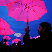 "Francisco Mendez of Cambridge joins Pilobolus and hundreds of MIT students, faculty and staff to improvise a performance called ""UP: The Umbrella Project"" using programmable umbrellas outfitted with LED lights at MIT, Sunday, May 19, 2013."