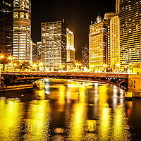 Picture of Chicago at night with State Street Bridge. Photo includes Trump Tower, Equitable Buildings, London Guarantee Building, and Hotel 71.