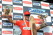 November 4th 2010: Duane Desoto of Hawaii hold up his trophies during the final day of competition of the ASP World Longboard Championship at Makaha Oahu-Hawaii. Photo by Matt Roberts/mattrIMAGES.com.au