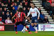 Christian Eriksen (23) of Tottenham Hotspur looks for a way past Nathan Ake (5) of AFC Bournemouth during the Premier League match between Bournemouth and Tottenham Hotspur at the Vitality Stadium, Bournemouth, England on 4 May 2019.