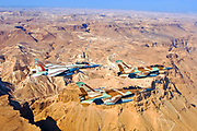 A formation of 2 F-16 and one F-15 Israeli Air Force fighter jets flying over Masada, Dead sea area, Israel