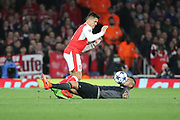 Bayern Munich midfielder Arturo Vidal (23) with a challenge on Arsenal attacker Alexis Sanchez (7) during the Champions League round of 16, game 2 match between Arsenal and Bayern Munich at the Emirates Stadium, London, England on 7 March 2017. Photo by Matthew Redman.