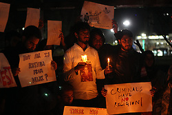 April 16, 2018 - India - People hold candles and placards as they participate in the protest demanding justice for 8-year old Asifa Bano in Srinagar,Kashmir on April 16, 2018. Asiifa, the nomadic gujjar child was brutally raped and murdered in Kathua district of Jammu in January 2018. The Crime Branch of Police has filed a charge sheet of the case in a local court and indicted eight people in the case. (Credit Image: © Faisal Khan/Pacific Press via ZUMA Wire)