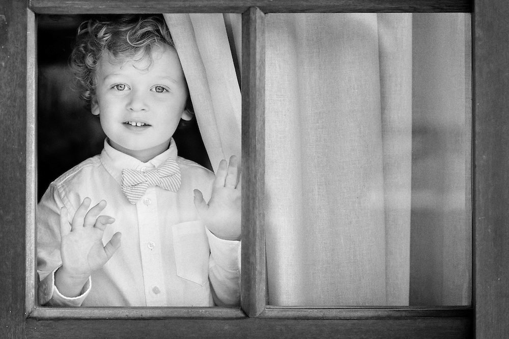 Ring Bearer framed by the window at a wedding in Puerto Vallarta.  Image by Puerto Vallarta Wedding Photographer Michelle Turner.