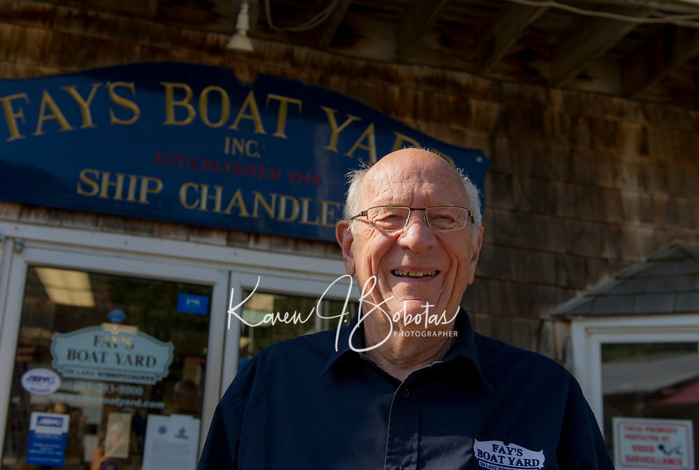 Merrill Fay outside of the Ship Chandlery at Fay's Boat Yard on Lake Winnipesaukee in Gilford NH.   © Karen Bobotas Photographer