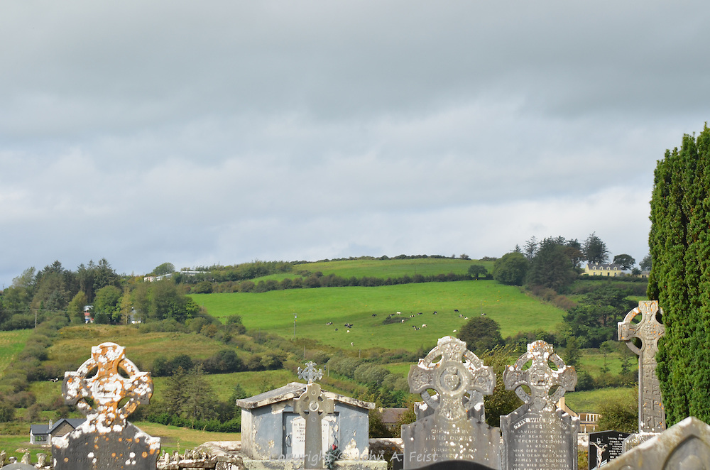 Looking out over the cemetery of St Carthage Church to the surrounding farms.  Brosna, County Kerry, Ireland