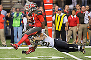 NEW ORLEANS, LA - SEPTEMBER 20:  Jameis Winston #3 of the Tampa Bay Buccaneers is tackled by Kenny Vaccaro #32 of the New Orleans Saints at Mercedes-Benz Superdome on September 20, 2015 in New Orleans Louisiana. The Buccaneers defeated the Saints 26-19.  (Photo by Wesley Hitt/Getty Images) *** Local Caption *** Jameis Winston; Kenny Vaccaro