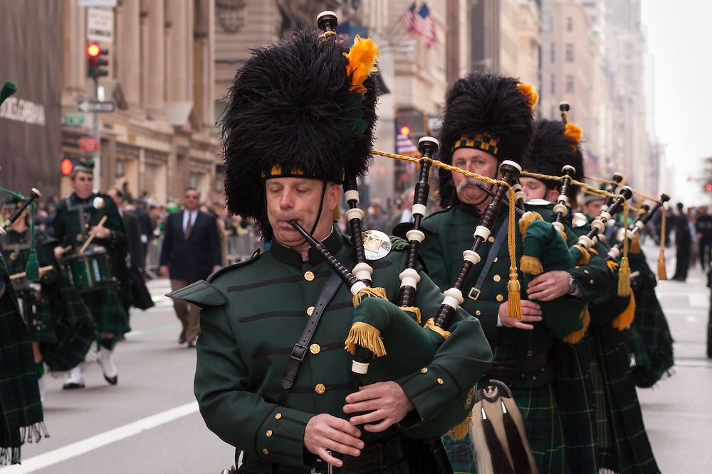 A pipe band marching in the parade.